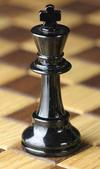 <tt>Chess piece Black king by MichaelMaggs via Wikimedia Commons</tt>